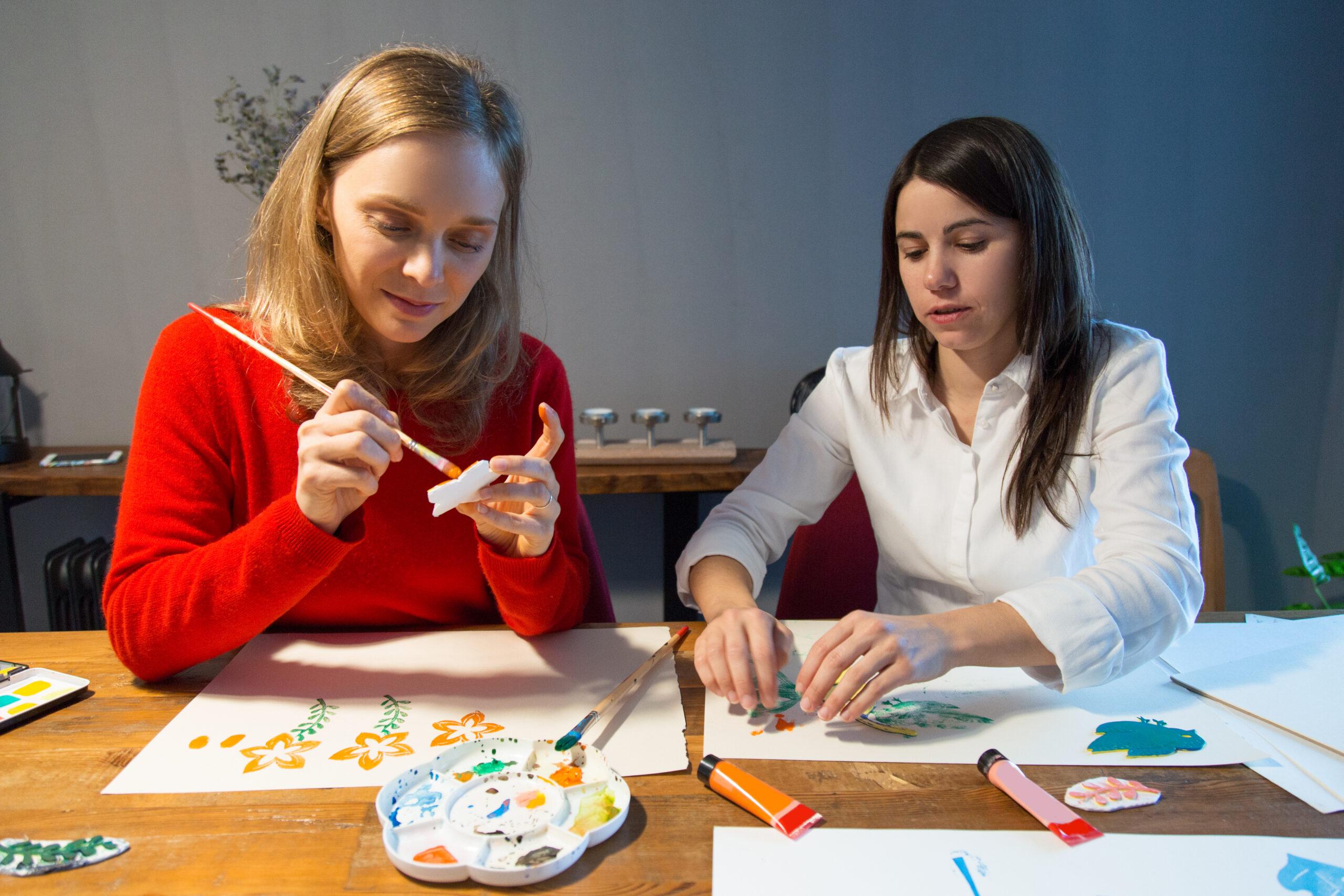Two peaceful girls enjoying simple painting